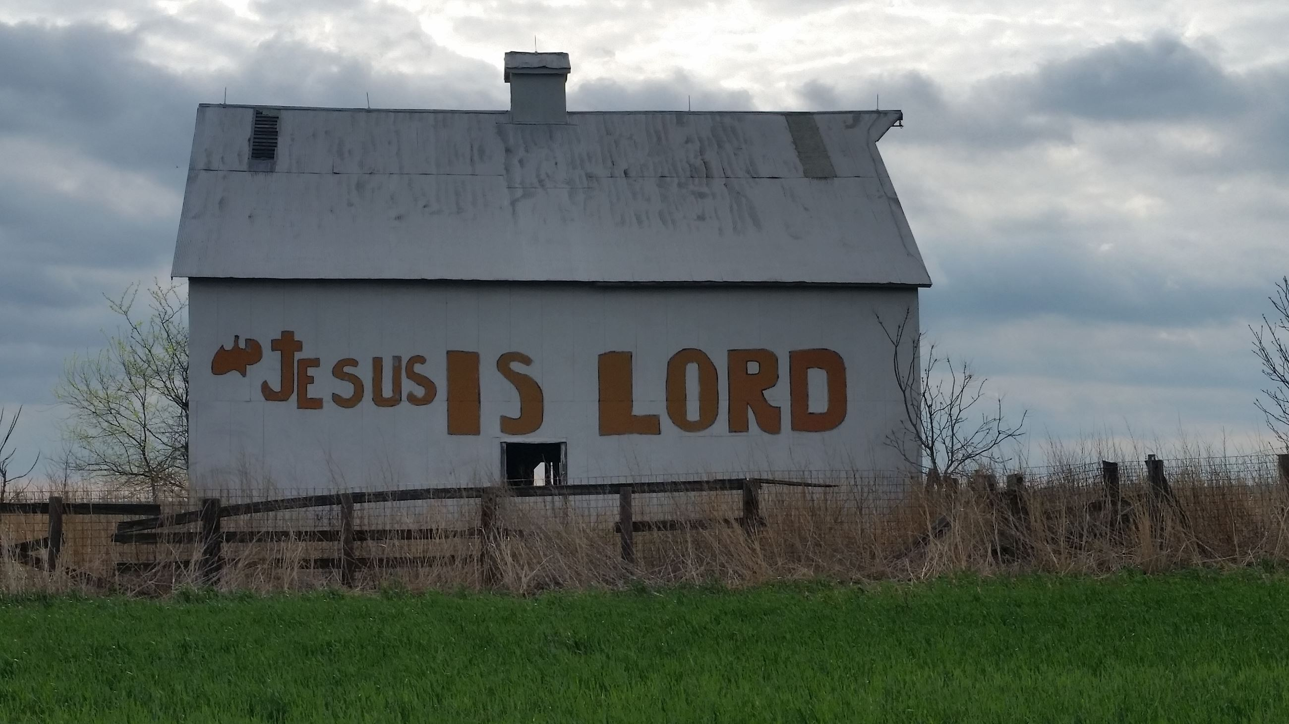 Jesus Is Lord Painted on White Barn