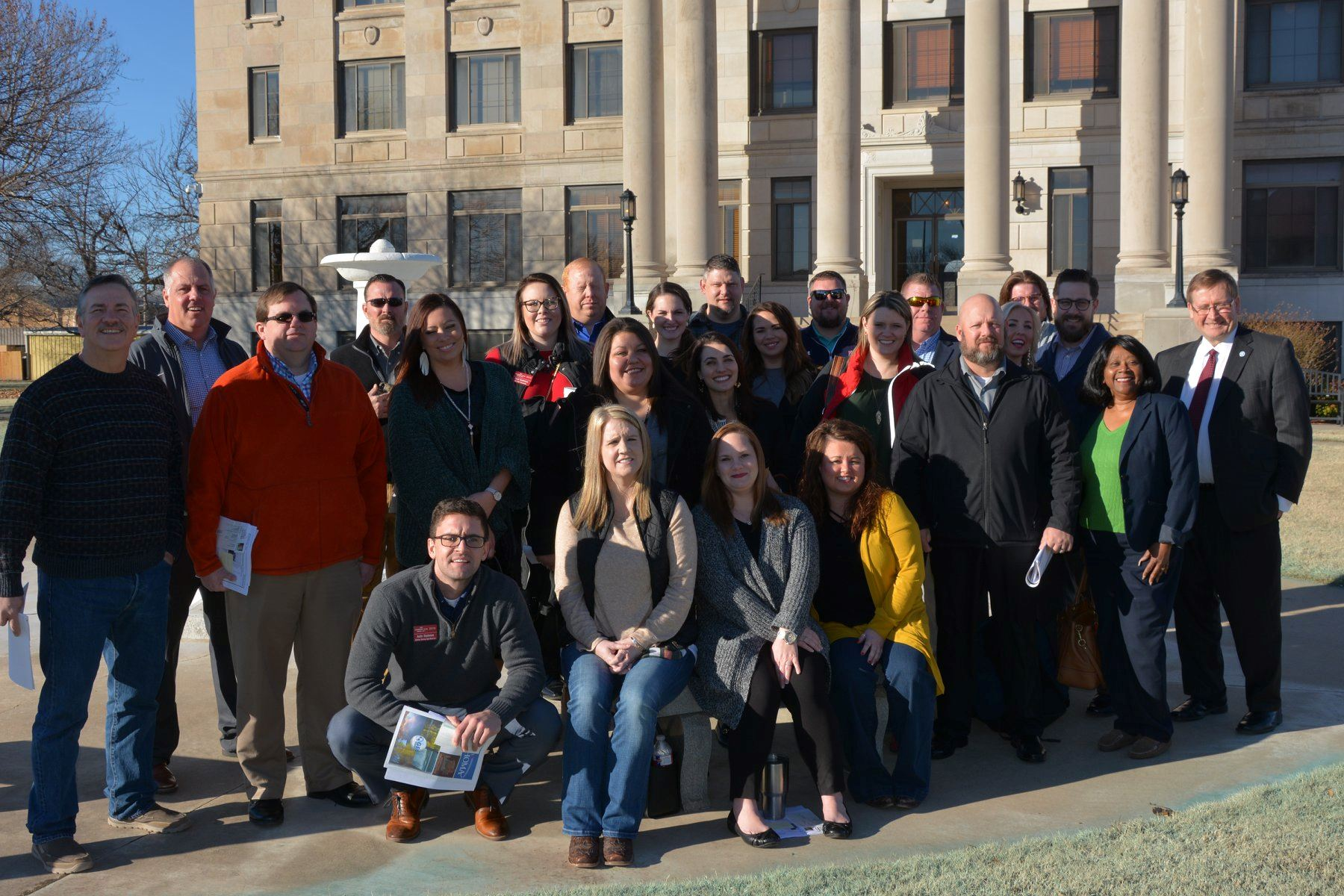 Ponca City Leadership Poses in Front of Kay County Courthouse